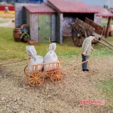 Campesinos con carretilla (2 hombres y 1 mujer) - Miniatura 1:32 - Presier 63078 en diorama